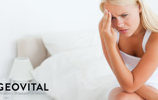 Lady with headache from radiation on bed