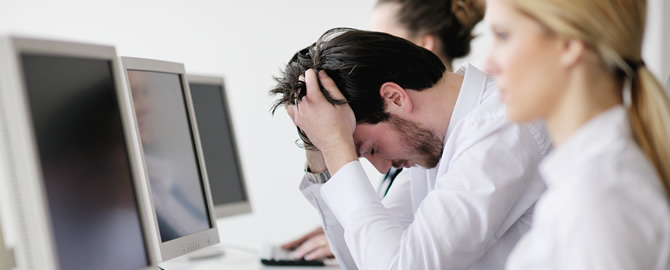 Sick employee working on the office computer